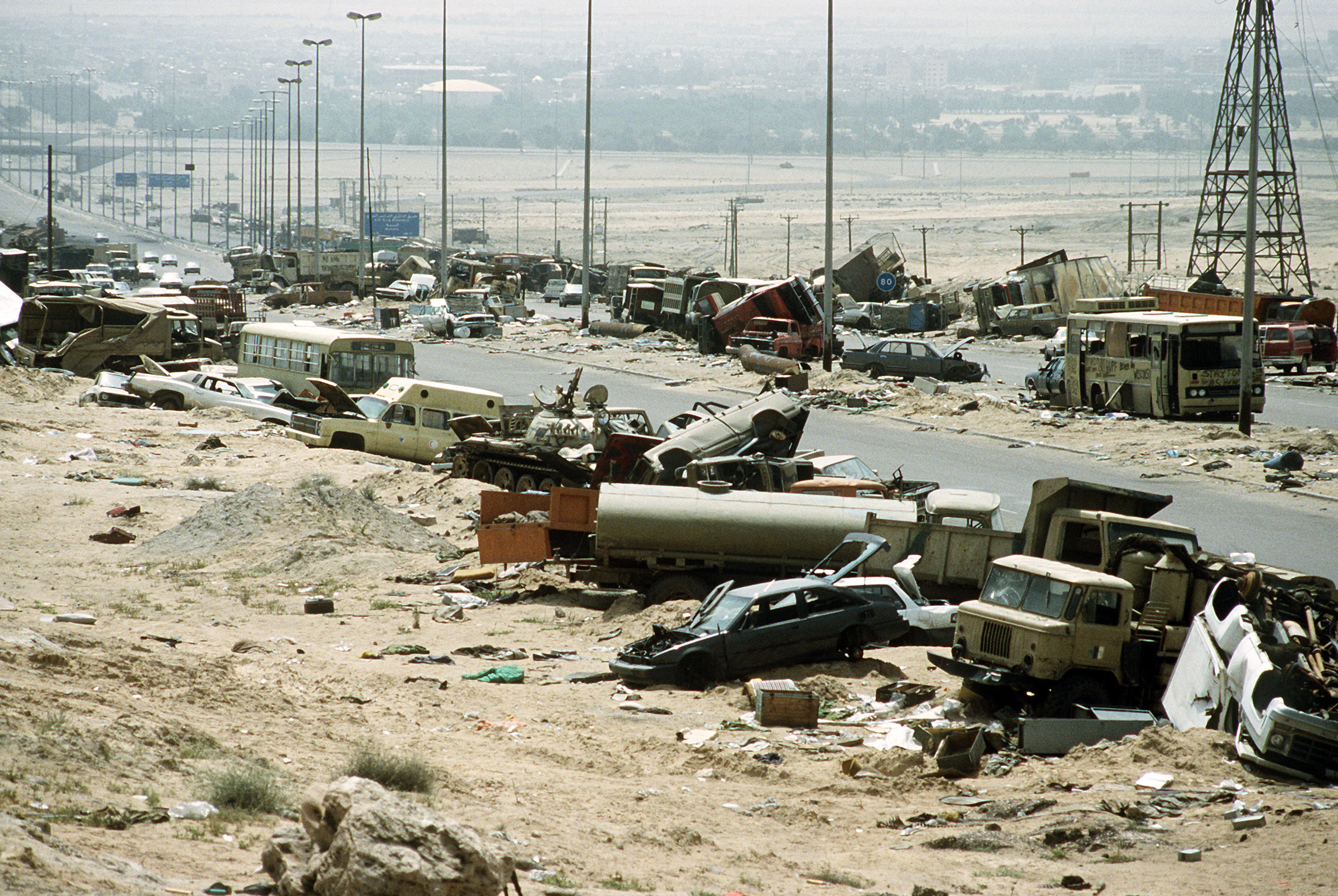 Demolished vehicles line highway 80 on 18 apr 1991